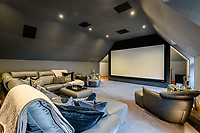 BNPS.co.uk (01202) 558833. <br /> Pic: TailorMade/BNPS<br /> <br /> Pictured: Cinema. <br /> <br /> A multi-millionaire is hoping to have a shot at selling his luxury mansion - by throwing a hi-tech golf simulator into the deal.<br />  <br /> Golf-loving Barry Bester put the waterfront property on Sandbanks, Dorset, on the market for £11m last year.<br />  <br /> He is now offering his £40,000 state-of-the-art simulator he has had built on the grounds with the sale.