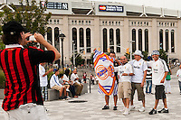 Real Madrid fans pose for a photo in front of Yankee Stadium prior a 2012 Herbalife World Football Challenge match against A. C. Milan at Yankee Stadium in New York, NY, on August 8, 2012.