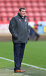 Partick Thistle v St Johnstone....25.10.14   SPFL<br /> Tommy Wright watches the rain soaked game<br /> Picture by Graeme Hart.<br /> Copyright Perthshire Picture Agency<br /> Tel: 01738 623350  Mobile: 07990 594431