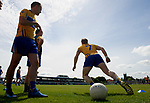 The Clare team warm up in the sunshine before their Munster championship quarter-final game against Limerick in Cusack park. Photograph by John Kelly.