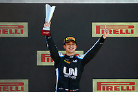 18th July 2021; Silverstone Circuit, Silverstone, Northamptonshire, England; F2 British Grand Prix, Race Day;  Zhou Guanyu (chn), UNI-Virtuosi Racing, Dallara F2 celebrating his victory on the podium during the 4th round of the 2021 FIA Formula 2 Championship