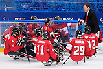 Sochi, RUSSIA - Mar 13 2014 - Head Coach Mike Mondin talks to the team late in the game as Canada takes on USA in Sledge Hockey Semi-Final at the 2014 Paralympic Winter Games in Sochi, Russia.  (Photo: Matthew Murnaghan/Canadian Paralympic Committee)