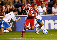 Chicago Fire midfielder Cuauhtemoc Blanco (10) dribbles in between Kansas City midfielders Kerry Zavagnin (5) and Sasha Victorine (9).  The Chicago Fire defeated the Kansas City Wizards 2-0 at Toyota Park in Bridgeview, IL on August 25, 2007.