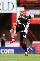 Brentford's Josh DaSilva celebrates with Said Benrahma who tries to keep hold of the match ball at the final whistle after scoring three goals during Brentford vs Wigan Athletic, Sky Bet EFL Championship Football at Griffin Park on 4th July 2020