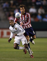 Real Salt Lake forward Robbie Findley (10) and Chivas USA defender Carey Talley (12) battle in the air for a ball late in the second half of a MLS game. Real Salt Lake defeated Chivas USA 1-0 at Home Depot Center stadium in Carson, California on Saturday, June 14, 2008.