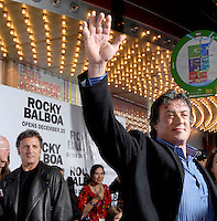 "Sylvester Stalone, right, acknowledges fans chanting his name as he walks the red carpet at the Prince Theatre for the ""ROCKY 6"" film premire in Philadelphia, Monday, Dec. 18, 2006. At left is Stalone's brother Frank Stalone. World Picture News/Bradley C Bower"