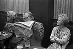 Working Mens Club, Saturday night entertainment.  Coventry Warwickshire 1981. Husband and wife reading newspaper. I suspect the sports pages.