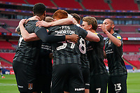 Ryan Watson of Northampton Town (8) celebrates with team mates after he scores the opening goal during the Sky Bet League 2 PLAY-OFF Final match between Exeter City and Northampton Town at Wembley Stadium, London, England on 29 June 2020. Photo by Andy Rowland.