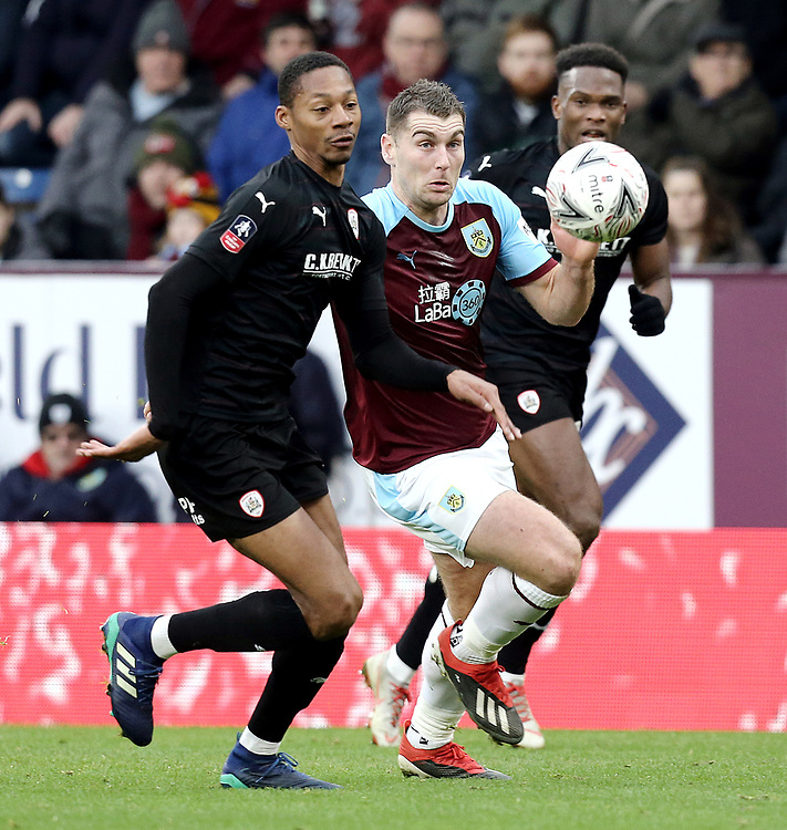 Burnley's Sam Vokes vies for possession with Barnsley's Ethan Pinnock<br /> <br /> Photographer Rich Linley/CameraSport<br /> <br /> Emirates FA Cup Third Round - Burnley v Barnsley - Saturday 5th January 2019 - Turf Moor - Burnley<br />  <br /> World Copyright © 2019 CameraSport. All rights reserved. 43 Linden Ave. Countesthorpe. Leicester. England. LE8 5PG - Tel: +44 (0) 116 277 4147 - admin@camerasport.com - www.camerasport.com