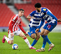6th February 2021; Bet365 Stadium, Stoke, Staffordshire, England; English Football League Championship Football, Stoke City versus Reading;  Josh Laurent of Reading clears the ball from Jack Clarke of Stoke