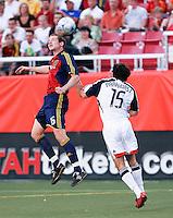 Real Salt Lake's Kenny Deuchar (16) goes up for the header in front of New England Revolution's Michael Parkhurst (15) in the Real Salt Lake 2-1 win over New England Revolution on June 21, 2008 at Rice-Eccles Stadium in Salt Lake City, Utah