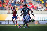 Orlando, Florida - Saturday, June 04, 2016: Paraguayan midfielder Edgar Benitez (11) dribbles away from Costa Rican midfielder Celso Borges (5) during a Group A Copa America Centenario match between Costa Rica and Paraguay at Camping World Stadium.