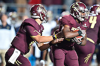 Texas State quarterback Tyler Jones (2) handoff to running back Robert Lowe (28) during second half of NCAA Football game, Saturday, September 13, 2014 in San Marcos, Tex. Navy defeated Texas State 35-21.(Mo Khursheed/TFV Media via AP Images)