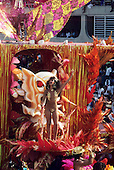 Rio de Janeiro, Brazil. Scantily clad woman on a red and gold float.