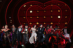 """Robyn Hurder, Ricky Rojas, Aaron Tveit, Danny Burstein, Karen Olivo, Tam Mutu and Sahr Nguajah during the Broadway Opening Night performance Curtain Call bows for """"Moulin Rouge! The Musical"""" at the Al Hirschfeld Theatre on July 25, 2019 in New York City."""