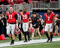 ATLANTA, GA - DECEMBER 7: Georgia captains, Jake Fromm #11, D'Andre Swift #7 and J.R. Reed #20 of the Georgia Bulldogs take the field for the coin toss during a game between Georgia Bulldogs and LSU Tigers at Mercedes Benz Stadium on December 7, 2019 in Atlanta, Georgia.