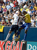 Clint Dempsey and Juan go up for a header during a USA vs Brazil international friendly which Brazil won, 4-2, at Soldier Field, Chicago, IL on September 9, 2007.