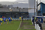 Glossop North End 0 Barnoldswick Town 1, 19/02/2011. Surrey Street, North West Counties League Premier Division. Glossop North End (blue strips) in action action as their club play Barnoldswick Town in the Vodkat North West Counties League premier division at the Surrey Street ground. The visitors won the match by one goal to nil watched by a crowd of 203 spectators. Glossop North End celebrated their 125th anniversary in 2011 and were once members of the Football League in England, spending one season in the top division in 1899-00. Photo by Colin McPherson.