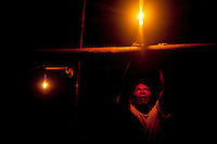 Quemonga Yate lights a candle in the Waorani (Huaroni) community of Cononaco Chico.