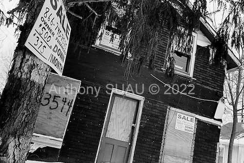 Cleveland, Ohio.March 10, 2008 ..Boarded up homes that have been foreclosed on in intercity Cleveland. Nearly every street in the city has at least one of these homes. Most have several. The owners of the homes, in many cases the mortgage companies, have the responsibility of maintaining the homes. Often squatters, drug dealers and the homeless move into the abandon homes. Many times the copper pipes and wiring are stripped out of the homes by thieves to sell as scarp metal.