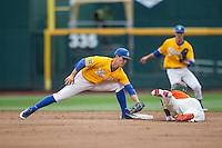 UC Santa Barbara Gauchos second baseman JJ Muno (9) reaches to tag the runner out at second base as Miami Hurricanes baserunner Carl Chester (9) arrives during Game 5 of the NCAA College World Series on June 20, 2016 at TD Ameritrade Park in Omaha, Nebraska. UC Santa Barbara defeated Miami  5-3. (Andrew Woolley/Four Seam Images)