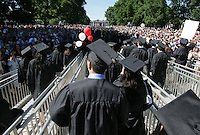 Graduating students make their way down the lawn during the 2006 gradution ceremonies Sunday May 21, 2006 at the University of Virginia in Charlottesville, Va. Photo/Andrew Shurtleffgraduate celebrate happy