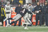FOXBOROUGH, MA - NOVEMBER 24: New England Patriots Cornerback Stephon Gilmore #24 tackles Dallas Cowboys Wide Receiver Amari Cooper #19 during a game between Dallas Cowboys and New England Patriots at Gillettes on November 24, 2019 in Foxborough, Massachusetts.
