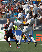 C.D. Olimpia forward Douglas Caetano (18) heads the ball. In an international friendly, AC Milan defeated C.D. Olimpia, 3-1, at Gillette Stadium on August 4, 2012.