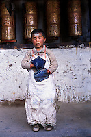 Devout pilgrim, Jyekundo, Kham, Tibet ,2005.<br /> This young boy has prostrated around the monastery so many times for good merit that he has a blister on his forehead and wears leather mitts to protect his hands.