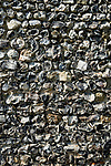Close up detail of a knapped flint stone wall. Arundel, West Sussex, England. 2006.