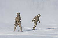 Ground crew fight to stay on their feet as a British Merlin helicopter comes in to land during practice in the Arctic, picking up loads in the terrain near Bardufoss, Norway. <br /> <br /> In 2019 the Arctic exercise Clockwork passed 50 years of training in Norway, and now has a permanent base within the Norwegian Air Force base at Bardufoss. <br /> <br /> 845 Naval Air Squadron is a squadron of the Royal Navy's Fleet Air Arm. Part of the Commando Helicopter Force, it is a specialist amphibious unit operating the Commando Merlin Mk3 helicopter and provides troop transport and load lifting support to 3 Commando Brigade Royal Marines.<br /> <br /> ©Fredrik Naumann/Felix Features