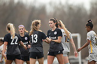 LOUISVILLE, KY - MARCH 13: Emina Ekic #13 and Cece Kizer #5 of Racing Louisville FC hug to celebrate a goal during a game between West Virginia University and Racing Louisville FC at Thurman Hutchins Park on March 13, 2021 in Louisville, Kentucky.