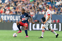 FOXBOROUGH, MA - JULY 7: Maciel #13 of New England Revolution controls the ball as Alejandron Pozuelo #10 of Toronto FC defends during a game between Toronto FC and New England Revolution at Gillette Stadium on July 7, 2021 in Foxborough, Massachusetts.