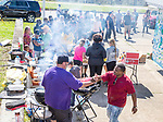 MARIANNA, FL - OCTOBER 13: Eugene Brown, right, shakes hands with a volunteer that's cooking. Brown and friends from the Class of 1994 at Marianna High School are  supplying free food after Hurricane Michael swept through this north Florida town on October 13, 2018 in Marianna, Florida. (Photo by Mark Wallheiser/Getty Images)