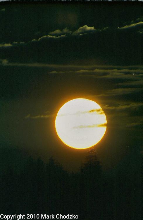 Ominous setting sun or full moon?
