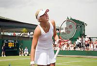 24-6-08, England, Wimbledon, Tennis,   Michaella Krajicek  verliest in de eerste ronde van haar dubbel partner Erakovic