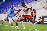 Juan Agudelo (17) of the New York Red Bulls is defended by Troy Cole (8) of FC New York. The New York Red Bulls defeated FC New York 2-1 during a third round match of the 2011 Lamar Hunt US Open Cup at Red Bull Arena in Harrison, NJ, on June 28, 2011.