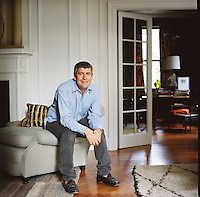 Keith Johnson at home in his Manhattan apartment