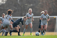 LOUISVILLE, KY - MARCH 13: Lauren Milliet #2 of Racing Louisville FC and Jadyn Chee #17 of West Virginia University battle for the ball during a game between West Virginia University and Racing Louisville FC at Thurman Hutchins Park on March 13, 2021 in Louisville, Kentucky.