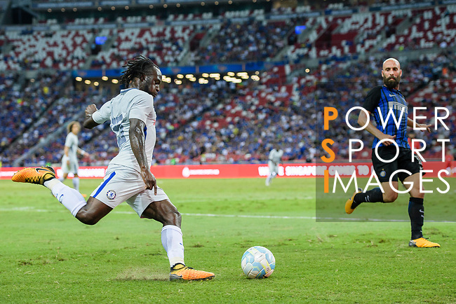 Chelsea Midfielder Victor Moses (L) attempts a kick while being defended by  FC Internazionale Midfielder Borja Valero (R) during the International Champions Cup 2017 match between FC Internazionale and Chelsea FC on July 29, 2017 in Singapore. Photo by Marcio Rodrigo Machado / Power Sport Images