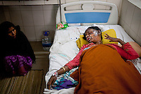Nurjahan, 35, one of the victims of a recent bomb attack in a bus, receives treatment at a medical college hospital during the ongoing nationwide blockade called by the opposition Bangladesh Nationalist Party (BNP), in Dhaka, Bangladesh, Sunday, Jan. 18, 2015.