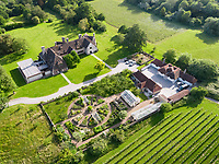 BNPS.co.uk (01202 558833)<br /> Pic: Hamptons/BNPS<br /> <br /> Pictured: The house, gardens and vineyard.<br /> <br /> An incredible Arts and Crafts country house with its own vineyard is on the market for offers over £7m.<br /> <br /> The Grade II listed St Joseph's Hall is a striking 111-year-old property that was home to the Bishop of Arundel for 40 years.<br /> <br /> It has a wealth of period features, an indoor swimming pool and seven acres of vineyard with mostly Chardonnay grapes, which the owners sell to a local winery.<br /> <br /> The house in Storrington, West Sussex, has 17 acres of land with beautiful views over the South Downs.