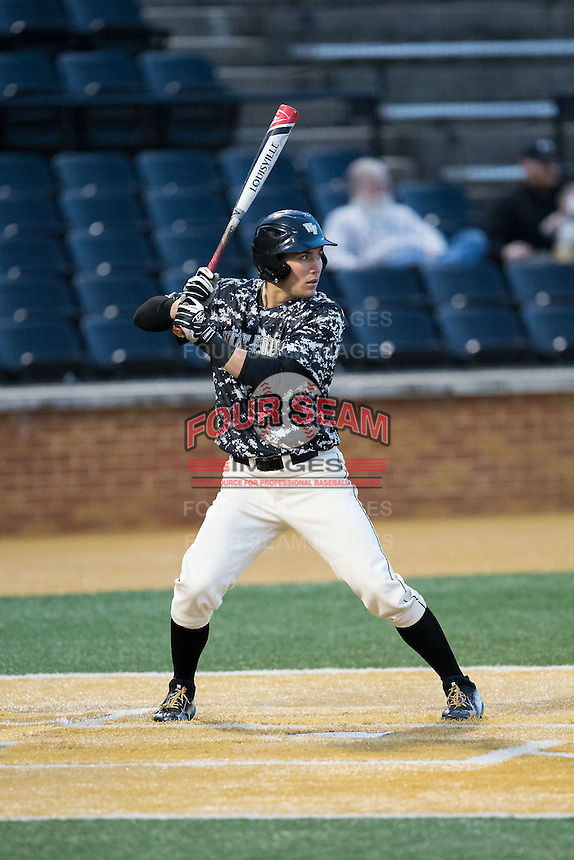 Keegan Maronpot (13) of the Wake Forest Demon Deacons at bat against the Miami Hurricanes at Wake Forest Baseball Park on March 20, 2015 in Winston-Salem, North Carolina.  The Hurricanes defeated the Demon Deacons 15-2.  (Brian Westerholt/Four Seam Images)