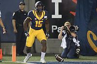 BERKELEY, CA - September 17, 2016: Jordan Veasy (15) celebrates scoring a first quarter touchdown. Cal played Texas at Cal Memorial Stadium.