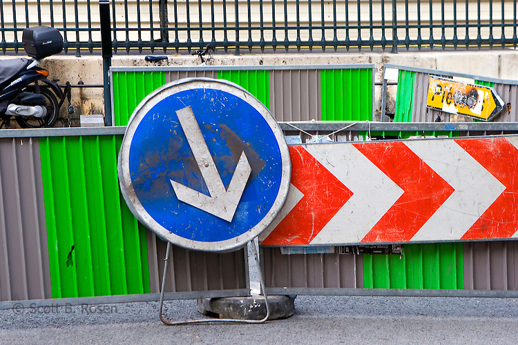 Various road signs and barricades in Paris, France