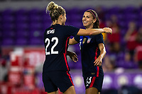 ORLANDO CITY, FL - FEBRUARY 24: Alex Morgan #13 and Kristie Mewis #22 of the USWNT celebrates her goal during a game between Argentina and USWNT at Exploria Stadium on February 24, 2021 in Orlando City, Florida.