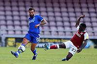 5th September 2020; PTS Academy Stadium, Northampton, East Midlands, England; English Football League Cup, Carabao Cup, Northampton Town versus Cardiff City; Christopher Missilou of Northampton Town challenges Maroln Pack of Cardiff City