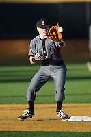 Ian Happ (5) of the Cincinnati Bearcats during infield practice prior to the game against the Wake Forest Demon Deacons at Wake Forest Baseball Park on February 21, 2014 in Winston-Salem, North Carolina.  The Bearcats defeated the Demon Deacons 5-0.  (Brian Westerholt/Four Seam Images)
