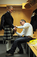 Pictured: Jazz Richards (L) is trying on a welsh kilt made by Tony Collins of the welsh tartan centre (R) at the Liberty Stadium, Swansea south Wales. Thursday 02 december 2011<br /> Re: