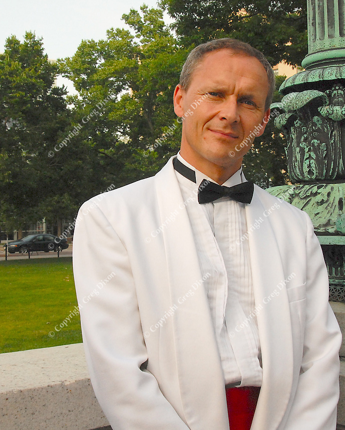 Conductor Andrew Sewell prepares for Concerts on the Square with a dress rehearsal Monday at the State Capitol in Madison